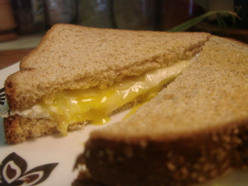 Fried egg and cheese sand plated