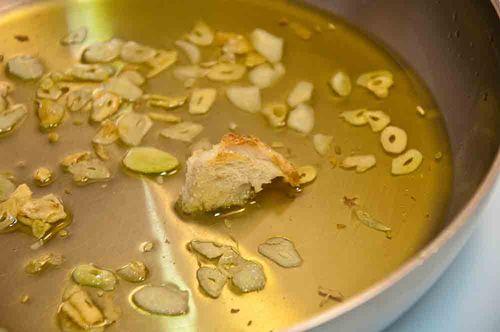 Dip crusty bread into garlic oil
